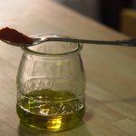 """aceite para Timbal de pulpo """"A Feira"""" sobre patata aliñada"""